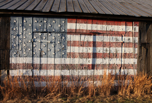 American flag painted on side of old Southern Maryland tobacco barn and dedicated to US Troops