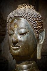Ancient Buddha head statue