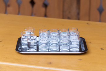 Shots of clear alcohol served on a tray
