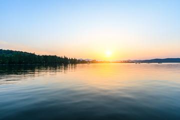 Beautiful lake and hill landscape at sunset