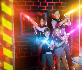 Kids and adults in beams on lasertag arena