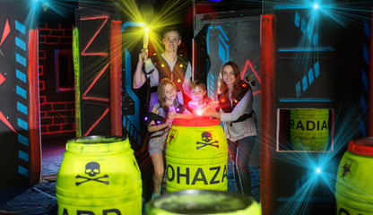 Kids and parents in beams during laser tag game