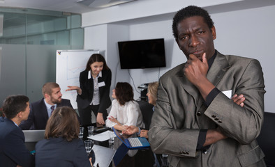 Discontent African American businessman in meeting room