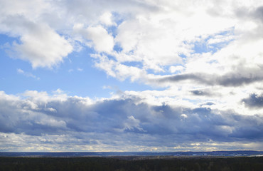 View of wide white clouds in the blue sky.