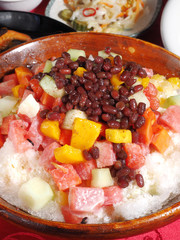 Shaved ice dessert with fresh fruit in the bowl
