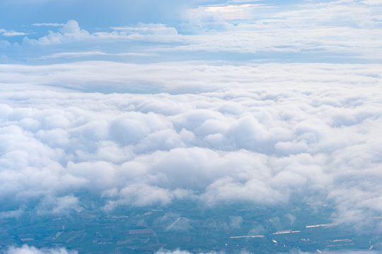 Big Blue sky and Cloud and city under cloud Top view from airplane window,Nature background.