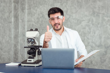 Portrait of young scientist research using microscope in a laboratory, Biotechnology, Science, Chemistry