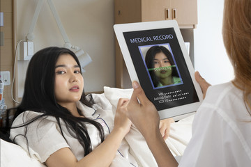 Wall Mural - Doctor scan patient face for searching medical record.