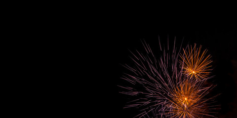 Spiky Orange and Purple Fireworks Background