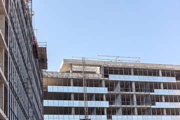 new apartments building under construction against clean blue sky