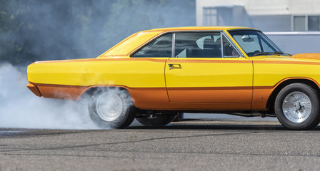 Drag race car burning rubber
