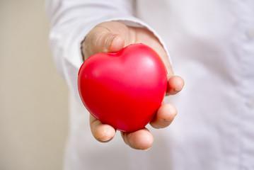Red heart on chilaren hand