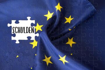 Flagge der EU als Puzzle und die Schulden