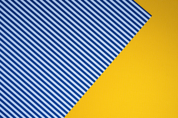 top view of blue striped and yellow dotted templates for background