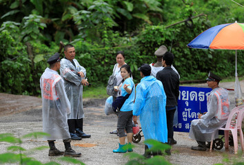 Relatives of boys trapped in a flooded cave are seen at a check point near the Tham Luang cave complex in the northern province of Chiang Rai, Thailand