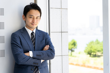 portrait of asian businessman relaxing