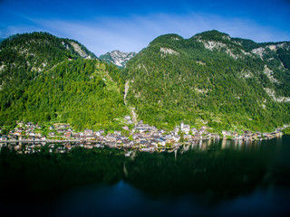Hallstatt is a beautiful small town in Austria. Travel to the Alps. City among the mountains in the Alps. town near the lake . View from above. Alpine town