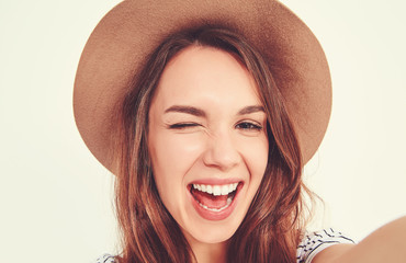 pretty girl in summer hipster clothes take selfie from hands with phone