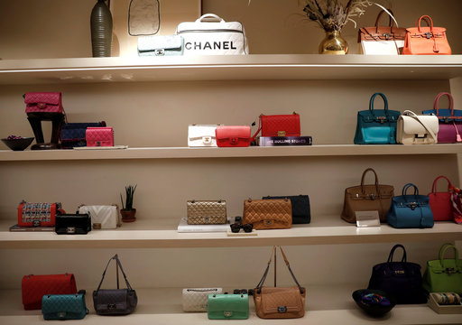 Luxury handbags for sale are displayed at The RealReal shop, a seven-year-old online reseller of luxury items on consignment in the Soho section of Manhattan, in New York City