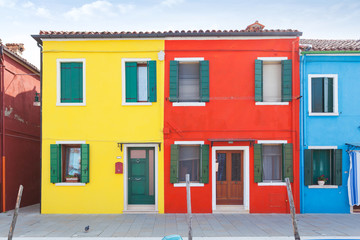 Rectilinear view of the colored facades of buildings on the island of Burano, near Venice, Italy