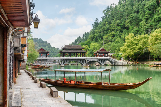 Parked wooden tourist boat on the Tuojiang River, Fenghuang