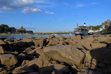 Sightseeing boats sit at the Elbe river in Dresden