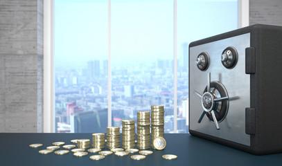Euro Geldmünzen mit einem Tresor auf dem Tisch