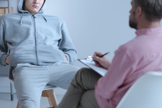 Juvenile offender talking to his curator during a meeting