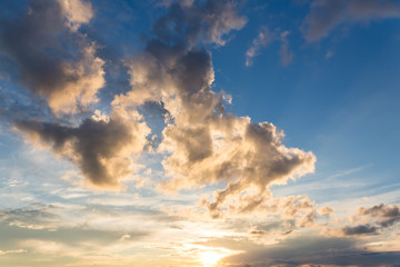 colorful sky with sun background in mountains. sunset, sunrise. Romantic sunset sky with fluffy clouds