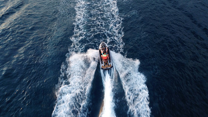 Aerial drone photo of Jet ski cruising in tropical waters