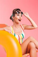 Full length portrait of a cheerful brunette pin-up girl