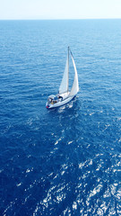 Aerial drone birds eye view of sail boat cruising the Aegean sea, Greece