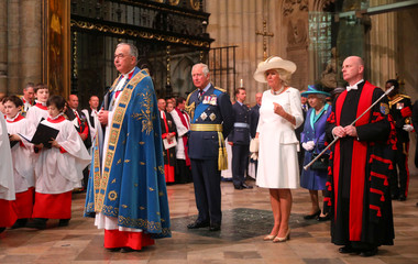 Britain's Queen Elizabeth, Prince Charles and Camilla, Duchess of Cornwall wait in Westminster Abbey for a service to mark the centenary of the Royal Air Force, in central London