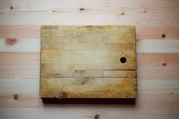 The wooden old cutting Board