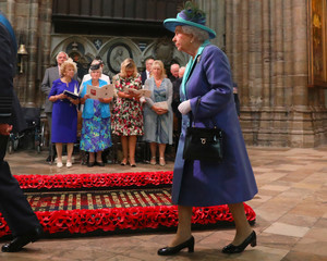 Britain's Queen Elizabeth arrives in Westminster Abbey for a service to mark the centenary of the Royal Air Force, in central London