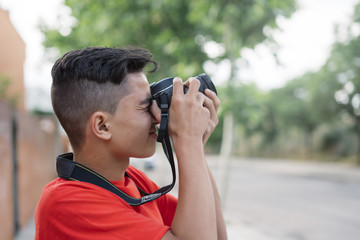 Portrait of young man taking a picture