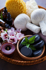 spa setting with hibiscus flowers on brown