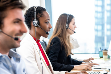 Diverse call center team working in office