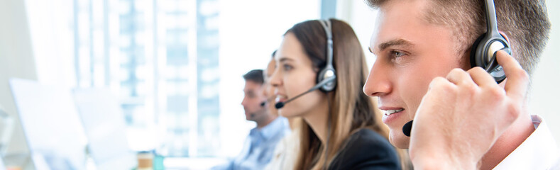 Male operator staff with team working call center