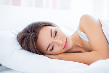 Portrait of sleepy woman having sweet dreams keeping eyes closed enjoying recreation having natural makeup