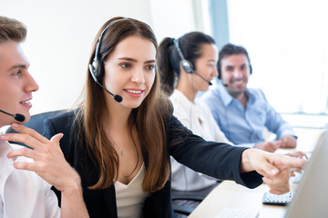 Businesswoman telemarketing staff working with coworker in call center office