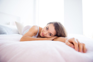 Portrait of calm peaceful girl lying on bed enjoying rest after hard day at home day health healthy