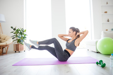 Wellbeing vitality practicing purpose sport clothing group coach in gym concept. Side profile view portrait photo of sexy sexual beautiful with long legs lady doing crunches sitting on the floor