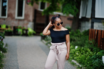 Stylish african american woman at sunglasses posed outdoor.