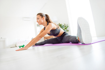 Style wellness vitality trendy modern enduring strength concept. Low angle close up photo portrait of beautiful charming lovely confident independent student coach club group gym stretching muscles