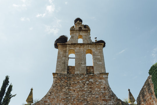 Bell tower of traditional spanish church and stork nests