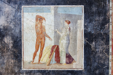 ancient fresco of Hercules on a black background in Pompeii house, Pompeii was destroyed by the eruption of the volcano Vesuvius in AD 79.