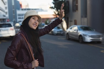 Woman gesturing in city street
