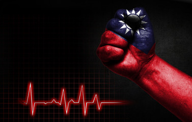 Flag of Taiwan painted on male fist, the concept image shows the strength of medicine or politics in countries, photography has a good place for your text