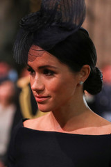 Britain's Meghan, the Duchess of Sussex arrives at Westminster Abbey for a service to mark the centenary of the Royal Air Force in central London